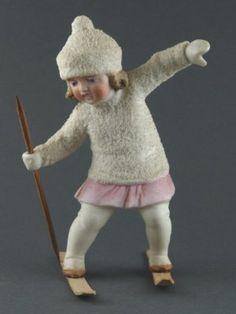 German bisque HERTWIG SNOW BABY GIRL ON SKI.