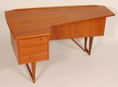 I like the asymmetrical shape on here - it's really intriguing, although as a desk I doubt there is enough room for my legs and the color is a little bright.