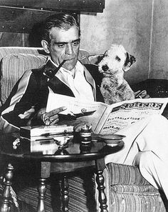 Boris Karloff with dog Whisky, relaxes while reading and smoking his pipe. Classic Horror Films Utopia on Facebook.