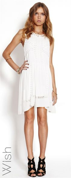 Diamond Dress The Wish Diamond Dress features triangle cut-out detailing and flattering fit throughout. This perfect sundress is ready for whatever your summer holds. 100% Viscose #WishDesigns