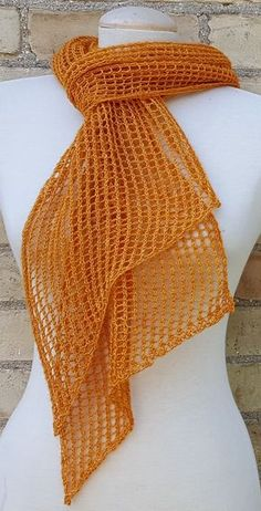 """Free Knitting Pattern for 2 Row Repeat Delta Scarf - A simple but elegant lace scarf worked on the bias in a 2 row repeat. 2 sizes: Small (S) (13"""" x 72"""") and Large (L) (18"""" x 86""""), requiring 50g and 100g of lace weight yarn, respectively. Designed by Galt House of Yarn."""