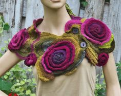 Crochet Scarf - Capelet. Unique scarf made Freeform method. Warm and pleasant to the touch. Beautiful unique design. Color: shadows purple/green One of a kind Size: one size fits all about: 104/25 cm 40,94/9,84 materials used: 30% wool, 70% acrylic Care instruction: hand wash using warm water. Because of different monitors and screen resolutions, colors may look different on the screen than really.