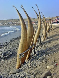 Caballitos - straw boats used by fishermen stored on Huanchaco Beach, Trujillo, Peru