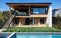 Villa gone rogue   Architecture Now Timber Stair, Timber Ceiling, New Zealand Image, Angled Ceilings, Narrow Garden, Internal Courtyard, Clerestory Windows, Outdoor Fire, House Made