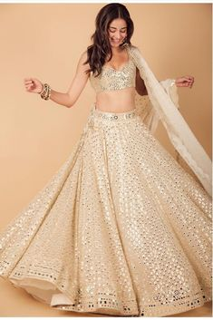 Ananya Panday makes a stunning statement in a gorgeous mirror work lehenga by Abhinav Mishra for Armaan Jain's wedding function. Indian Gowns Dresses, Indian Fashion Dresses, Indian Designer Outfits, Dress Fashion, Fashion Outfits, Indian Bridal Lehenga, Indian Bridal Outfits, Simple Lehenga, Lehenga Designs Simple