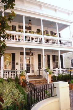 """Southern porch w blue ceiling - paint the ceiling blue on your porch and you won't have Mosquitos, flys, etc - they """"think"""" it's the sky and won't fly under it - very common n the south. ***ALSO- this is a picture of HUSK. a wonderful southern restaurant in Charleston, SC!! love it!"""