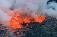 Nyiragongo Crater: Journey to the Center of the World - Bubbles of gas explode at the surface of the lava lake.