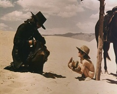 El Topo (1970) Director: Alejandro Jodorowsky - A surreal western, full of symbology.  A man on a quest encounters weirdness.