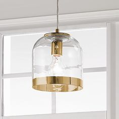 """Young House Love Metallic Rimmed Glass Pendant This Young House Love glass dome pendant is rimmed in Chrome or Gold for a clean and sophisticated edge. 9' of clear cord and 5"""" chrome canopy. (7.5""""H x 7""""W)."""