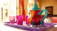 Tablescapes  To create a Moroccan-themed tablescape, start with a colorful palette of pretty jewel tones accented with metallics.