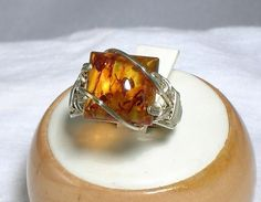 Hey, I found this really awesome Etsy listing at https://www.etsy.com/listing/60406768/baltic-amber-square-cabochon-ring-any