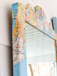 This mirror was calling out for more than a fresh coat of paint. It needed something graphic and maps were the perfect solution. And the map mirror was created.