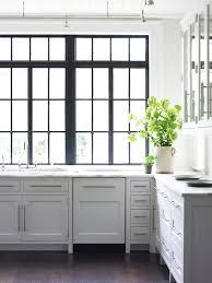 Love the kitchen windows and simple cabinet style!