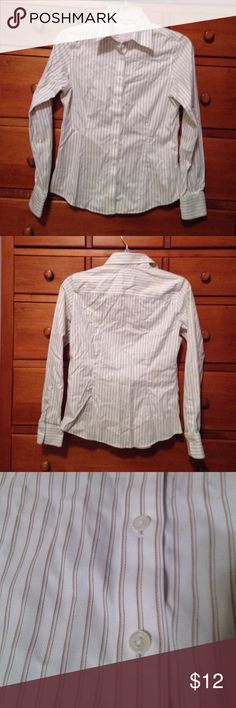 Brooks Brothers sz 4P button down striped shirt Brooks Brothers sz 4P button down striped shirt. Tailored fit. Non iron stretch. Cotton/lastol blend. Button on cuff and shirt opening at each cuff. Brooks Brothers Tops Button Down Shirts