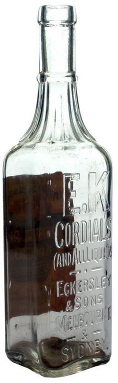 EK Cordials. Eckersley & Sons, Melbourne & Sydney. with Original label. Clear glass later variation. c1930s.
