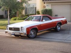 It's the car that looks like a truck - I love El Camino's.  :)