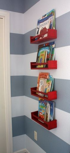 Stacked  IKEA bookshelves--painted red--punch up the gray-and-white stripes in this little boy's room.