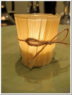 Corn Husk wrapped votives - makes for a gorgeous Thanksgiving table
