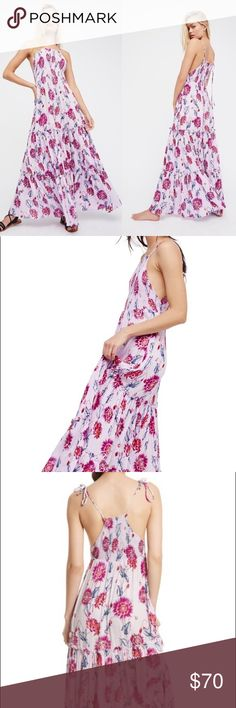 Free People Garden Party Maxi Dress Free People Garden Party Maxi Dress. Femme floral printed maxi dress featuring a stretchy smocked bodice and an effortless silhouette. Adjustable tie straps. Tiered design. Lightweight, semi-sheer fabrication.   Only worn about 3-4 times! Free People Dresses Maxi