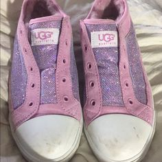 Genuine Ugg sparkly slip on sneakers! Worn maybe twice.  My daughter outgrew them already!  Lined in soft pink fur.   Non-lacing slip on shoes.  Great condition!   No flaws.  Just a smidgen of dirt on the white toe that will come off using Mr Eraser!  No box. UGG Shoes Sneakers