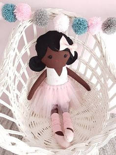 This sweet ballerina doll was handmade with love, so that you can give your child memories of playing, imagining and having fun that will last a lifetime. She has a lovely dark brown skin. Her hair is black and made from 100% wool felt and has a pink bow in it. She is wearing a white and pink dotted dress with a pink tutu. Her ballet slippers are light pink felt and her legwarmers are pink t-shirting fabric. The tutu and legwarmers are removable. If she gets dirty from lots of lovely play…