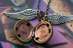 """Harry Potter Golden Snitch Necklace Gold Brass Locket Silver Wings"""" I Open at the Close"""" Ball Deathly Hallows. $16.00, via Etsy."""