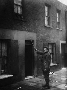 Jobs That No Longer Exist Today. Knocker-uppers were essentially alarm clocks – they were hired to ensure that people would wake up on time for their own jobs. They would use sticks, clubs or pebbles to knock on clients' windows and doors. Old London, East London, London Neighborhoods, Morning Call, Early Morning, Dockers By Gerli, London History, Delivery Man, How To Wake Up Early