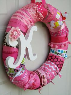 ribbon wreath - really cute baby gift with initial, great way to use scraps of ribbon!