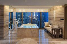 mandarin hotel Bathrooms | 50-sqm bathroom with a large bathtub and its own steam room. Bathroom ...