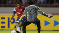 Costa Rican Allen Guevara (L) vies for the ball with Guyana's goalkeeper Derrick Carter during their Brazil 2014 FIFA World Cup North, Central America and Caribbean qualifier football match in San Jose on October 16, 2012. AFP PHOTO/Rodrigo ARANGUA