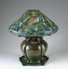 """Tiffany Studios, New York, Favrile Leaded Glass and Patinated Bronze """"Fish"""" Lamp. Love this lamp!"""