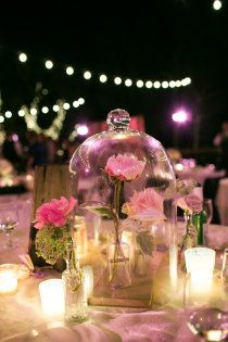 This table decoration reminds us of the classic Disney film, Beauty and the Beast! A pink rose for a romantic themed wedding.