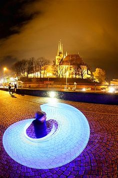 Nov. 13, 2012: A child spins with an illuminated glow stick near the Erfurt Cathedral in Erfurt, Germany, on Nov. 10. (© Imago/Zuma Press)