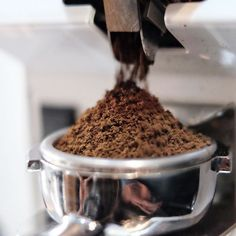 Freshly ground beans in a porta filter: A great cup of coffee about to happen!