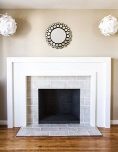 Amazing DIY Fireplace makeover, check out her process blog!  SwingNCocoa: Fireplace Makeover Part 2: Yummy Mantel