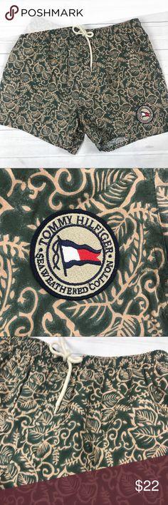 "Tommy Hilfiger Men' Large Swim Trunks Swimwear Tommy Hilfiger Men' Large Swim Trunks Swimwear 90's Floral green Patch  Tommy Hilfiger Swim Trunks/Suit Large Green Floral Patch to front Very Good Condition  Waist (Unstretched): 30-32"" Length: 16"" Inseam: 4""   J Tommy Hilfiger Swim Swim Trunks"