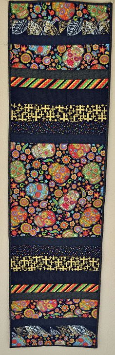 Dia de los Muertos, Day of the Dead Table Runner, quilted one of a kind long table runner with sugar skulls and coordinating fabrics