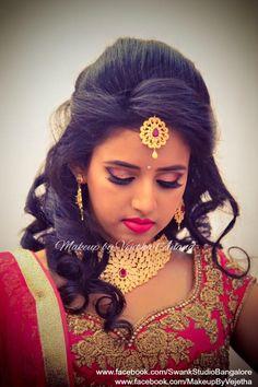Ashwini looks like a diva for her reception in a bridal lehenga and jewellery. Makeup and hairstyle by Vejetha for Swank Studio. Photo credit: Manish Ananda. Pink lips. Smokey glitter eye makeup. Bridal jewelry. Bridal hair. Curls. Indian Bridal Makeup. Indian Bride. Gold Jewellery. Statement Blouse. Tamil bride. Telugu bride. Kannada bride. Hindu bride. Malayalee bride. Find us at https://www.facebook.com/SwankStudioBangalore