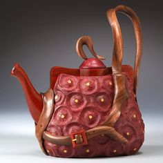 Wood carved teapot