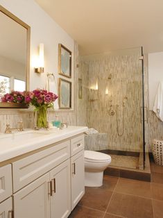 Annette English: Beautiful linear mosaic backsplash and shower tile. Pale gold mirror, contemporary light ...