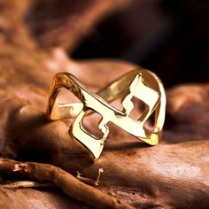 """AHAVA Ring Gold - A Perfectly Harmonious Symbol of Love Received by Dvora Perlman. The symbol in this Ring was created from the Hebrew word for love-""""AHAVA"""". Hebrew is the holy language of the Old Testament scripturesThe Hebrew language is a language with unique and strong kinetic attributes that influence our consciousness.   The symbol incorporated in this Ring consists of a number of elements."""