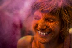Aug. 9, 2014. A reveler is covered in coloured powder,  during a Monsoon Holi Festival in Madrid, Spain.