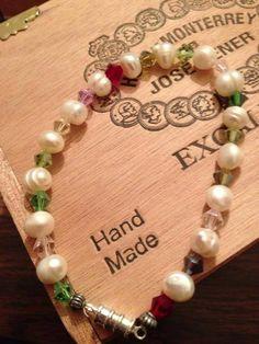 Crystals and fresh water pearls.   Burt's Bracelets https://www.facebook.com/BurtsBracelets