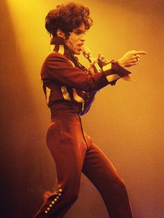 Prince: His Life in Pictures | 1993 | Shortly after changing his name to his symbol, the performer is seen onstage during his Act II Tour at the National Indoor Arena in Birmingham.