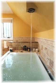 Kohler Soak Tub. The water over flows to create a waterfall sound, and bubbles and lights. I would never leave my tub!