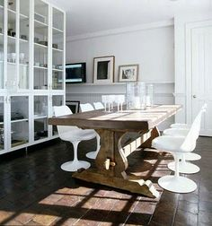 gorgeous rustic wood table perfectly juxtaposed by those chairs