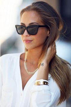 Definitely classy, big black sunglasses.... very Italian!