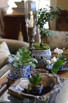 Blue and white decor paired with antique silver for lovely Spring or Summer time decor.