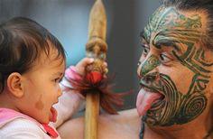 Image: Maori Wetini Mitaj-Ngatai shows his daughter, Niwareka, his war face at the Frankfurt Book Fair in Germany (© Boris Roessler/Corbis Images) We Are The World, People Of The World, Maori Tattoo Designs, Maori Tattoos, Borneo Tattoos, Face Tattoos, Tribal Tattoos, Polynesian People, Polynesian Culture