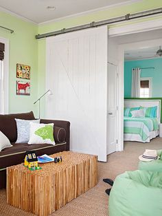 This sliding barn door is perfect for separating the celery green and turquoise bedroom